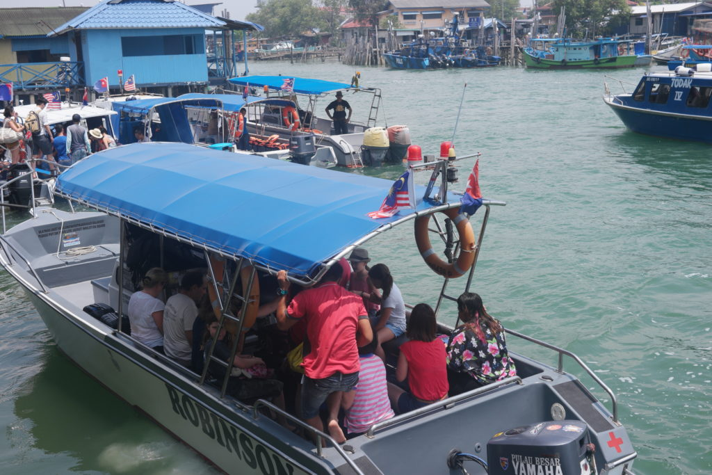 Boats departing from the jetty. Each boat carries around 12 people.