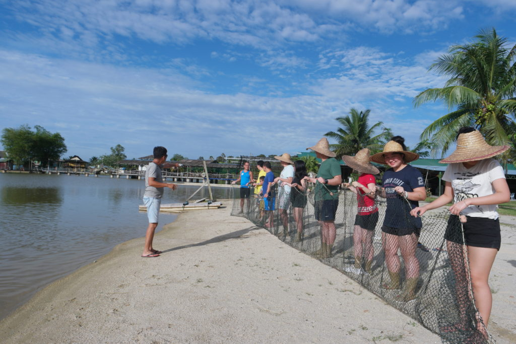 Farm owner giving us instructions for fish netting