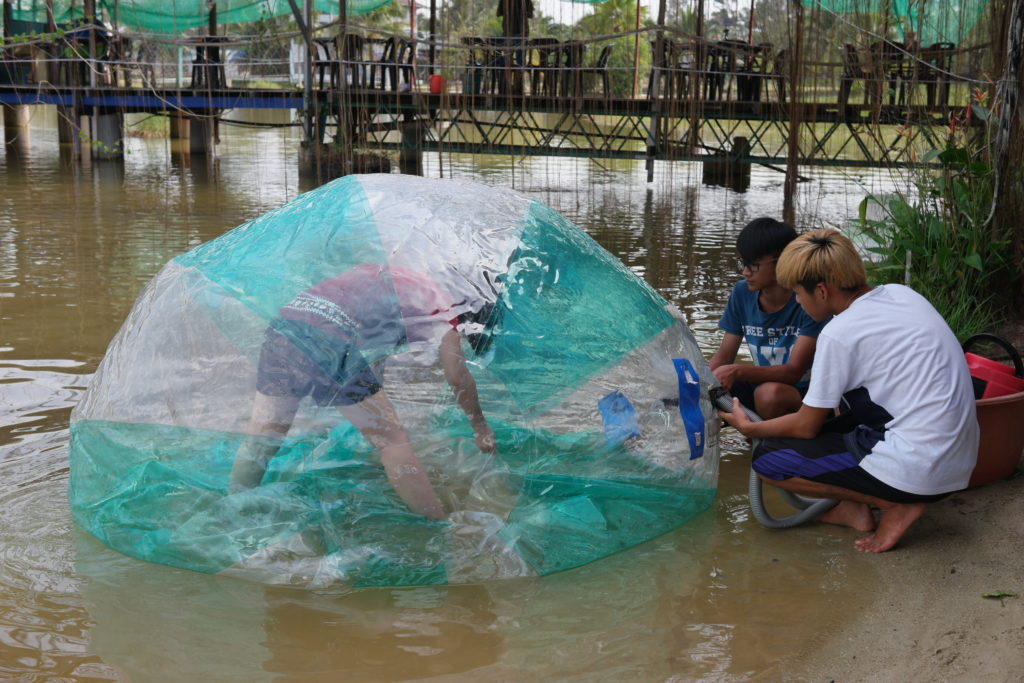 Inflating the water ball with Joey inside